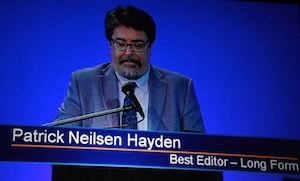 PNH accepting award, subtitled with chyron reading 'Patrick Neilsen Hayden'.